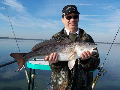fisherman with redfish