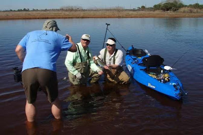 photographing guides with catch and kayak