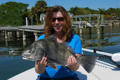 woman with black drum from docks