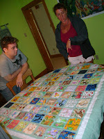 Alex and Debbie with the I Spy Quilt she made for Dayyán