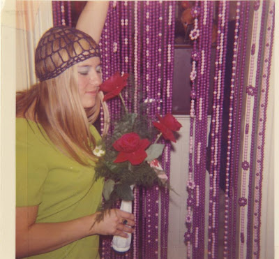 Nanci with her beaded curtains, made from Tilco hair balls. Photo taken in our apartment in London, Third year at Western University. Notice my Romeo and Juliet skull cap