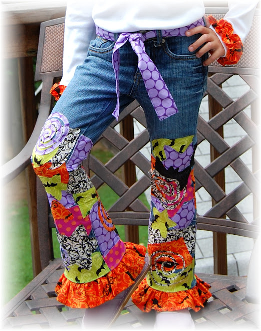 `CLOSEUP OF SPIDER JEANS SET