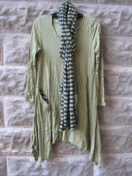 green tunic and stripe scarf