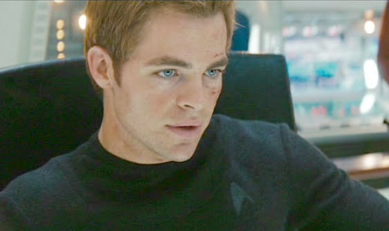 ... (Chris Pine), Spock (Zachary Quinto), and Dr. McCoy (Karl Urban), ...