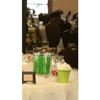 A green vase held the treat bags