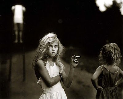 Sally Mann [n. 1951] | candy cigarette [1991]