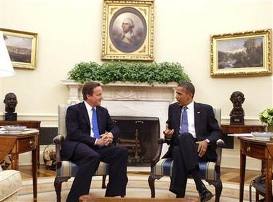 July 20,2010: David Cameron (L) makes his first visit to the White