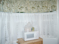 mismatched curtains floral tiers and plain white thin but not sheer tiers