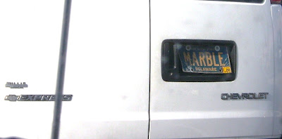 White van with a Delaware plate that says MARBLE on it