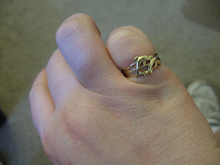gold ring with 2 dolphins