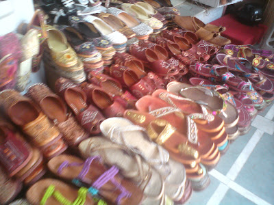Fancy footwear known as mochris or jootis in Jaipur shops