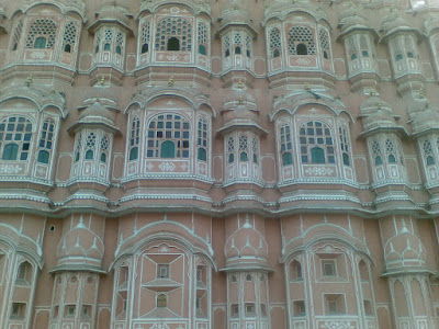 Delicately carved niches and windows of Hawa Mahal, Jaipur