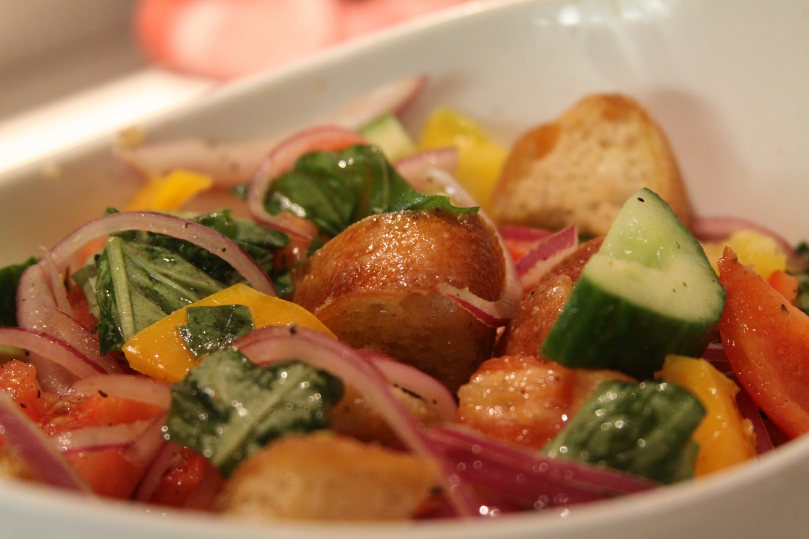 panzanella with heirloom tomatoes cucumber and peppers plate