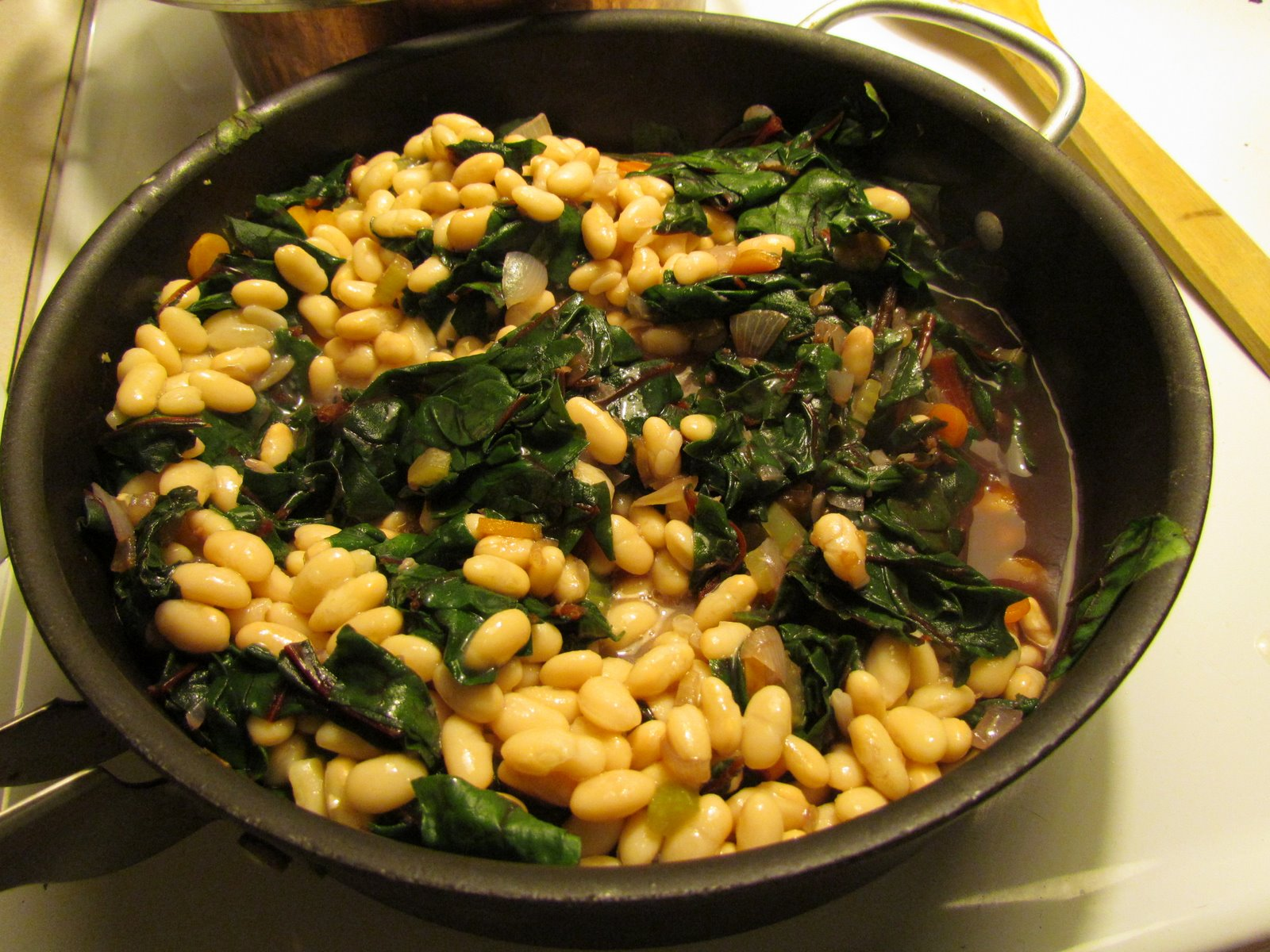 Eats and Thrifts: Eats - White Bean and Chard Stew with Poached Eggs ...