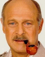 Gerald McRaney smoking a cigarette (or weed)