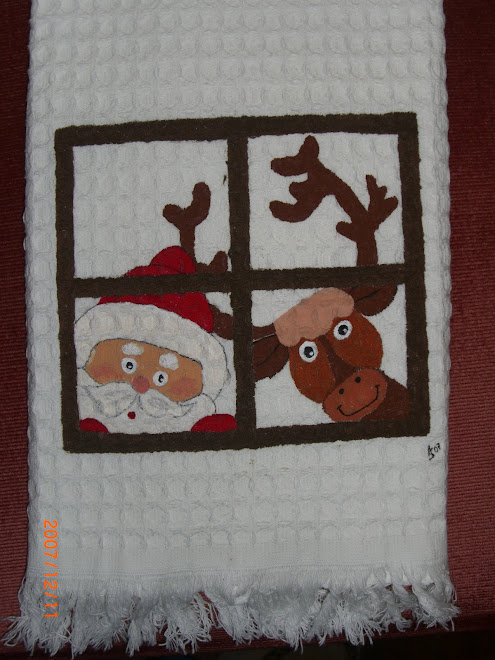 Janela com Rena e Pai Natal