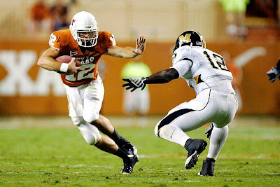 Foreshadowing? Texas Longhorns QB Colt McCoy gives a Missouri defender the Heisman pose