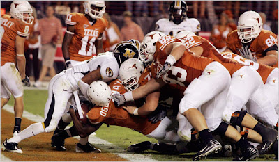 Texas Longhorns Running Back Chris Ogbonnaya Scores a Hard Faught Rushing Touchdown on the Missouri Tigers
