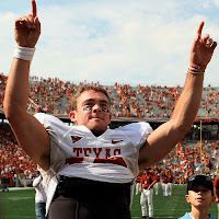 Texas Longhorn QB Colt McCoy Celebrating the Team's Victory Against the Oklahoma Sooners on October 11, 2008