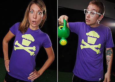 Johnny Cupcake - Green Cupcake and Crossbones Logo on a Purple T-Shirt