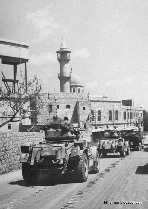 British armor on the way to Haifa port last day of British forces in Israel
