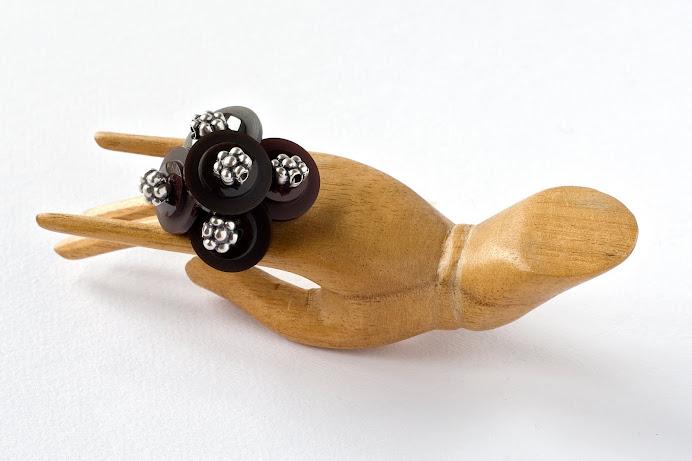 Anello bottoni vinile e argentone