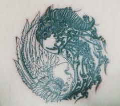 Yin-Yang Design Tribal Tattoo