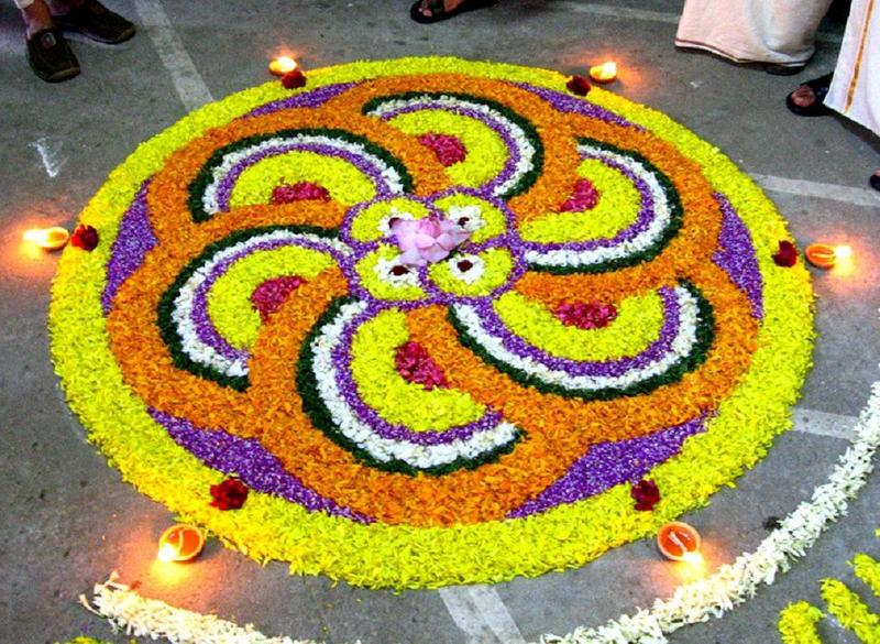 Photos onam pookalam floral design for Floor rangoli design