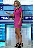 Rachel Riley short skirt and high heels