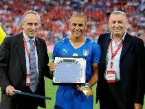 Cannavaro with Giancarlo Abete (l) & Gigi Riva (r)