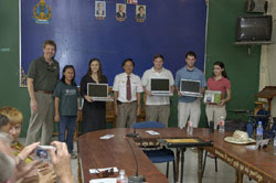 Our International Business Practicum class giving the laptops to the Wat Bo School