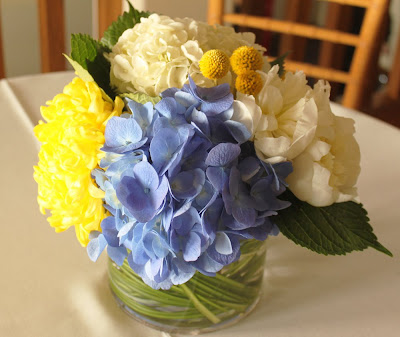 dark blue hydrangea white peonies and yellow billy buttons