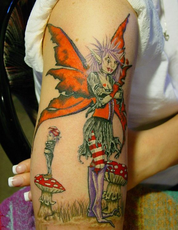 Female Tattoo Gallery With Fairy Tattoo Design On The Upper Arm