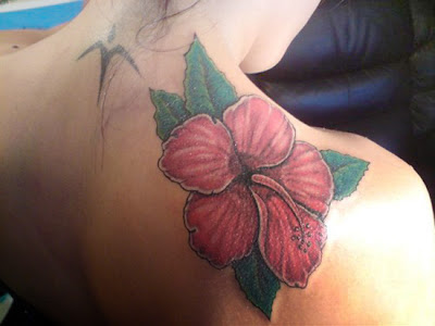 Hawaiian flower tattoos are exotic and beautiful and not as clichas rose or