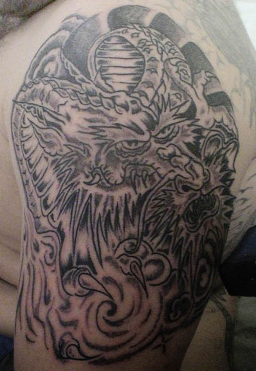 tribal dragon tattoo designs for men. Tribal forearm tattoo designs