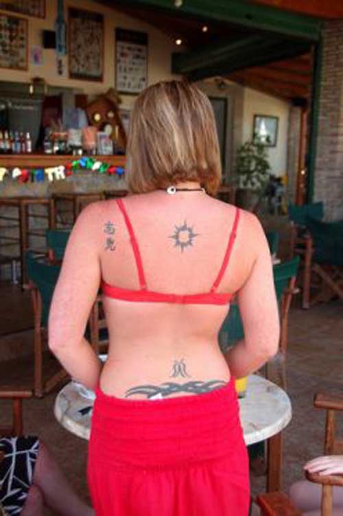 feminine lower back tattoo designs picture | gallery lower back tattoo designs