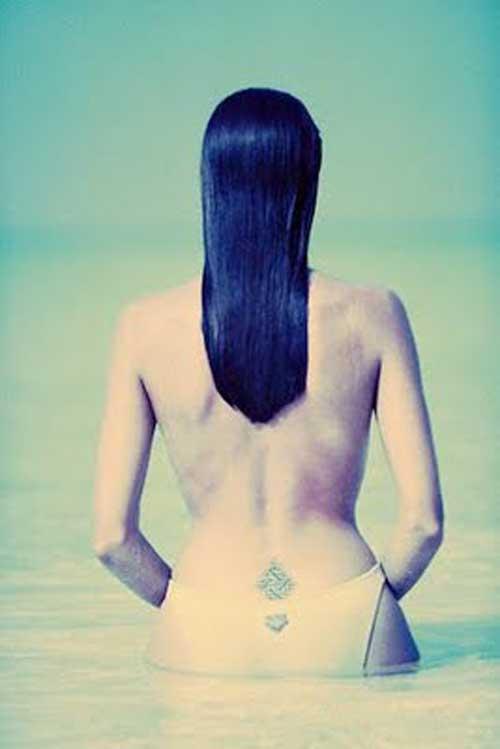 Labels: art feminine lower back tattoos, black feminine tattoos,