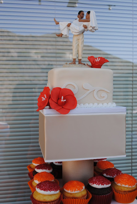 ... orange gumpaste flowers. The cupcakes were red velvet, chocolate, and