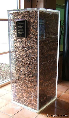 2.3 Tons of pennies  sit in this glass box. It is part of a Holocaust memorial,What  $1 Million Pennies Look Like
