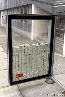 Most people have  seen this picture floating around on the internet. Very simple and catchy  advertisement. The money was real, but there was a security guard posted to make  sure no one tried anything funny, like running over the sign with a SUV, Security Glass Advertisement