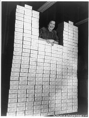 Stack of Silver Certificates, A woman posed with stack of packages of $1 silver certificates at the  Bureau of Engraving and Printing, Washington, D.C. [between ca. 1950 and ca.  1969]