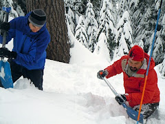 Tim and Brian checking snow