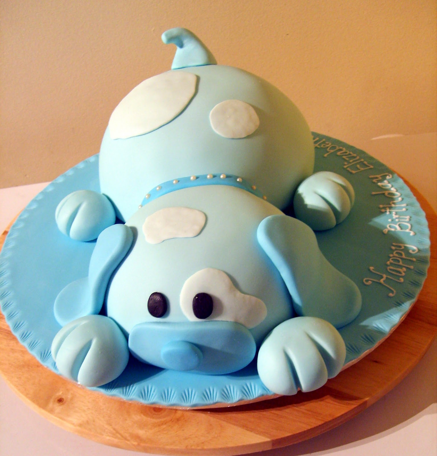 Pictures of Dog Cakes http://caketopia.blogspot.com/2010/12/puppy-dog-birthday-cake-for-elizabeth.html