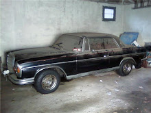 Old dusty black Mercedes
