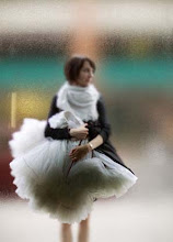 Girl carrying petticoat through glass