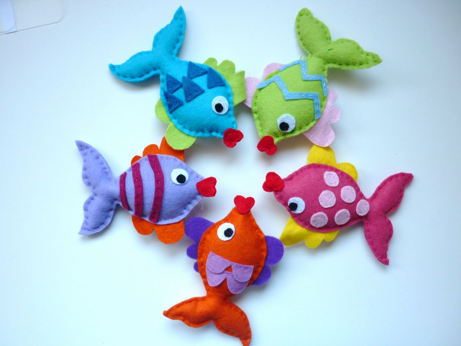 rainbow kissing fish mobile - meet the colourful 'rainbow kissing fish' soon to be hung as a baby mobilei am thinking of hanging from a felt covered ring with waves and maybe afew