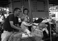 Little Girls Riding Carousel