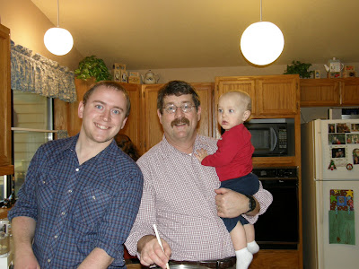 Three generations of Voelker men, cooking together