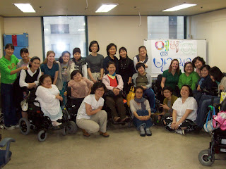 The staff and members of Women with Disabilities Empathy, plus Amber, Bridget, Sunghee and Kyunghee