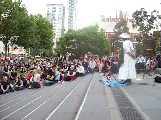 Ursula speaks to the Reclaim the Night crowd on the steps of the State Library